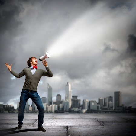 Portrait of young man shouting loudly using megaphone Stock Photo - 21185966