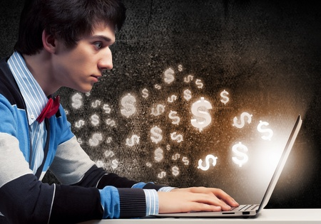 make money: Image of young businessman at work using laptop Stock Photo