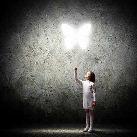 Image of little cute girl holding butterfly balloon photo