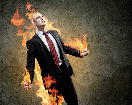 amok: Image of young businessman in anger burning fire Stock Photo