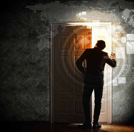 Image of young businessman opening the door Stock Photo