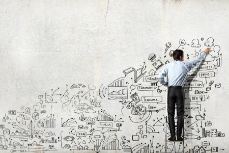 Back view of businessman drawing sketch on wall Stock fotó - 21246887