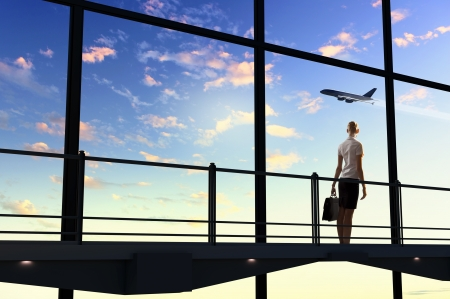 airplane take off: Image of businesswoman at airport looking at airplane taking off
