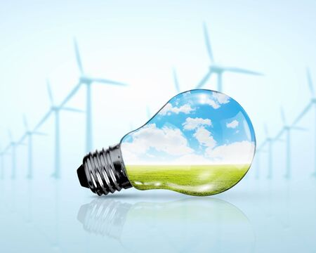 Electric bulb and windmill generators  Renewable energy concept photo