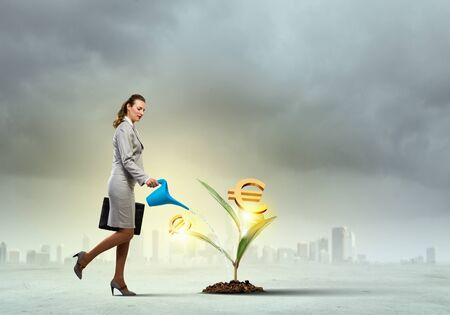 commercial tree care: Image of business woman watering money tree  Currency concept