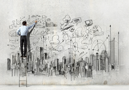 Back view of businessman drawing sketch on wall Stock Photo - 21247140