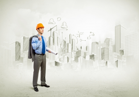 architect drawing: Image of man engineer in helmet with drafts  Construction concept Stock Photo