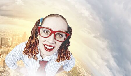 Funny looking red-hair woman with glasses staring at camera photo
