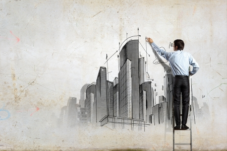 Back view of businessman drawing sketch on wall Stock Photo - 21247166