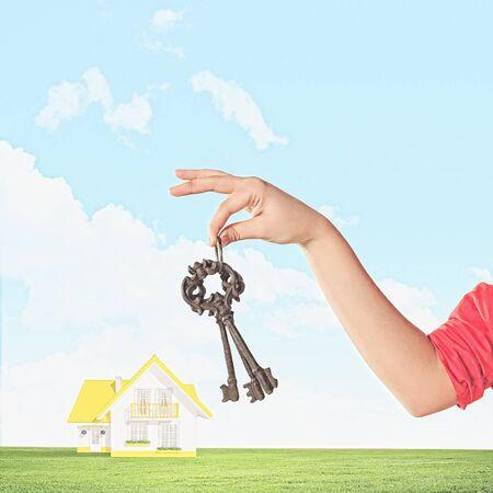 Close up image of human hand holding keys