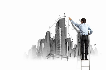Back view of businessman drawing sketch on wall Stock Photo - 21247532