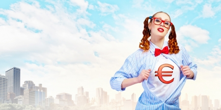 Young woman acting like hero with euro sign on chest photo