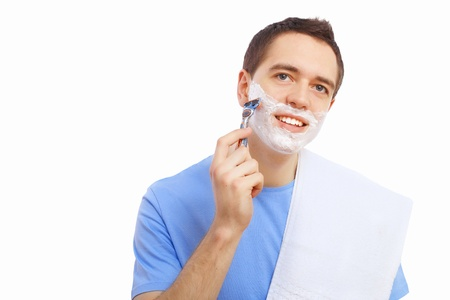 Young man at home shaving himself in the morning Stock Photo - 21271769