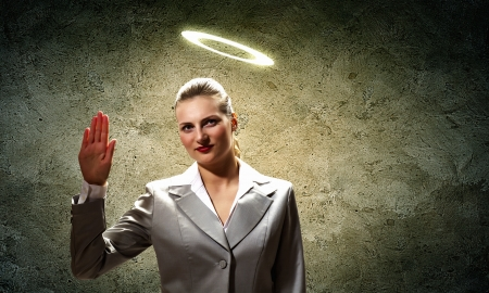 vow: Image of businesswoman with halo above head