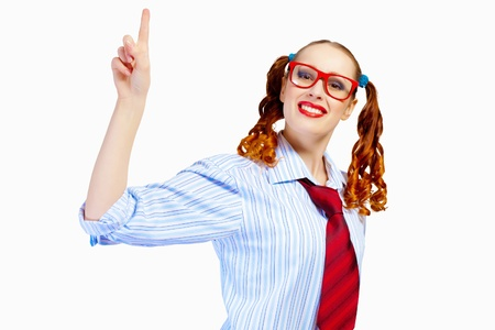 Image of pretty teenager girl in red glasses pointing with finger photo