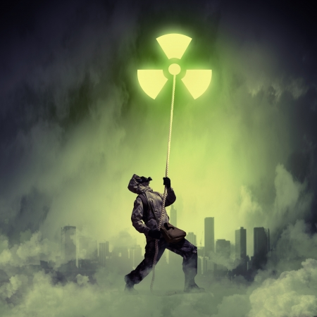 Man in respirator against nuclear background  Radioactivity concept photo