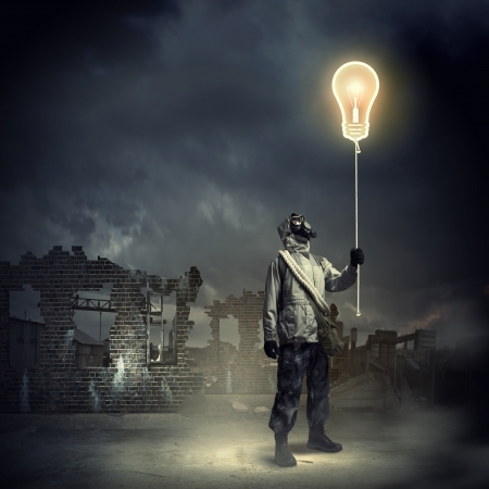Man in respirator against nuclear background touching symbol  Pollution concept Stock Photo - 21292057
