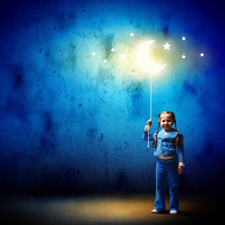 Image of little cute girl with moon on rope photo