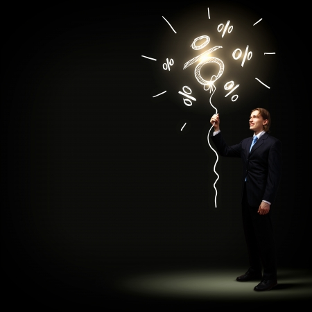 Image of businessman in black suit against dark background 版權商用圖片 - 21322471