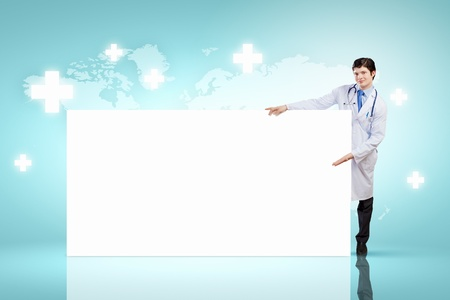 Young male doctor with blank banner  Place for text photo