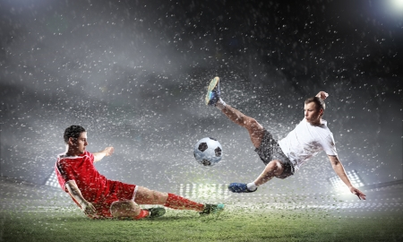 Image of two football players at stadium Stock Photo