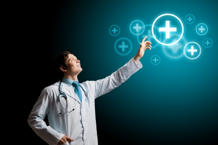 young male doctor: Young male doctor touching digital lightened image