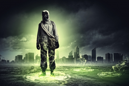 isotope: Man in respirator against nuclear background touching symbol  Pollution concept Stock Photo