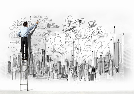 Back view of businessman drawing sketch on wall Stock Photo - 21331787
