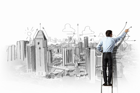 Back view of businessman drawing sketch on wall Stock Photo - 21331802