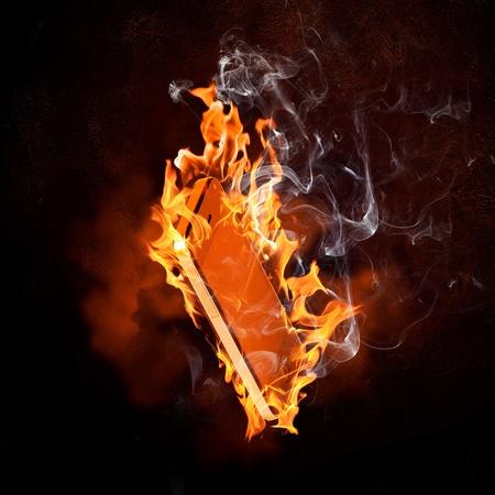 Image of burning book against black background photo