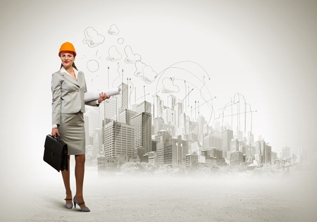 Image of woman engineer in helmet with drafts  Construction concept Stock Photo - 21331901