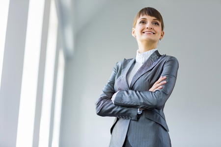 Image of young attractive businesswoman in business suit smiling photo