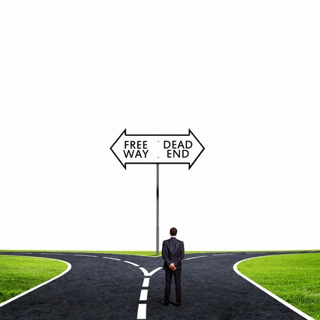 Back view of businessman standing at crossroads  Choice concept photo