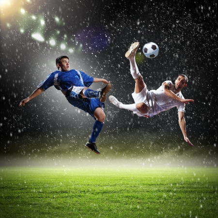 soccer goal: Image of two football players at stadium Stock Photo