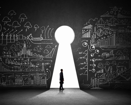 business opportunity: Silhouette of businessman against black wall with key hole