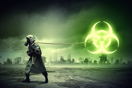 Man in respirator against nuclear background  Radioactivity concept Stock Photo - 21358303