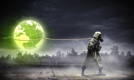 Man in respirator against nuclear background  Global pollution Stock Photo - 21358370