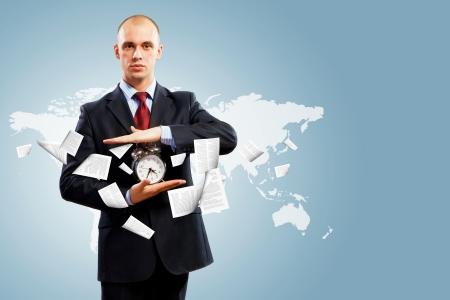 punctuality: Image of businessman holding alarmclock against illustration background  Collage