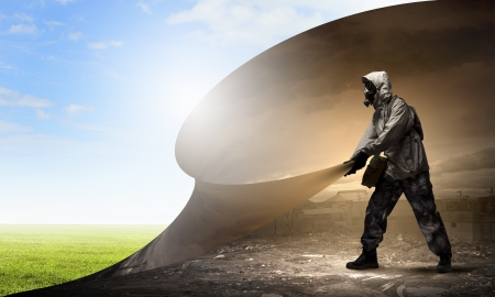 Image of man in gas mask turning page  Ecology concept Stock Photo - 21358543