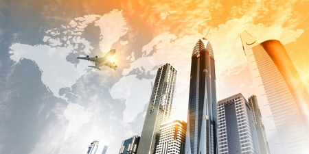 tallest: Plane flying above skyscrapers  Business travel concept Stock Photo