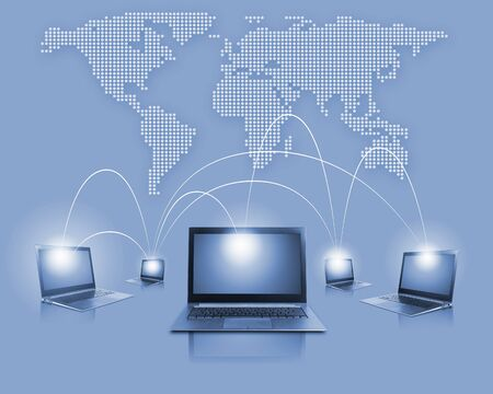 Laptops against world map background  Connection and cooperation photo