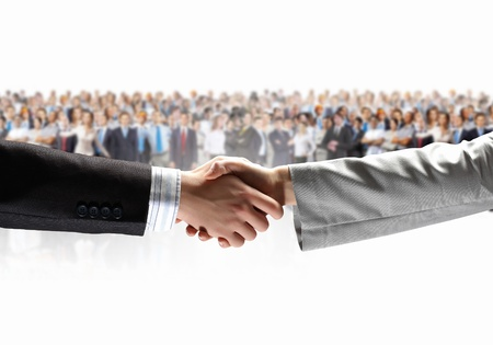 Handshake of business people with people at background photo