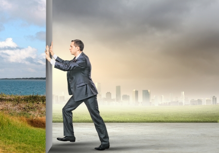 Image of young business man changing reality Stock Photo