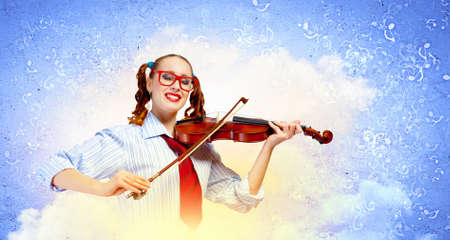 Image of young funny woman with violin against color background photo