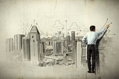 Back view of businessman drawing sketch on wall Stock Photo - 21402492