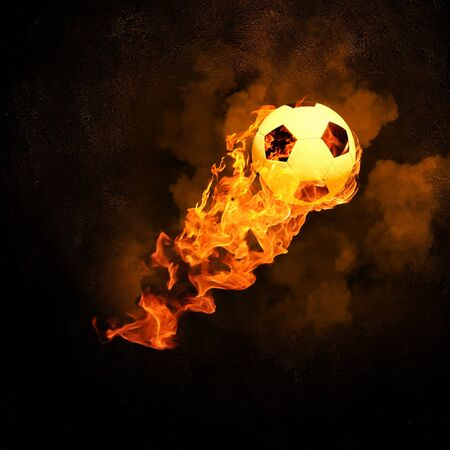 magic ball: Image of soccer ball in fire flames against black background Stock Photo
