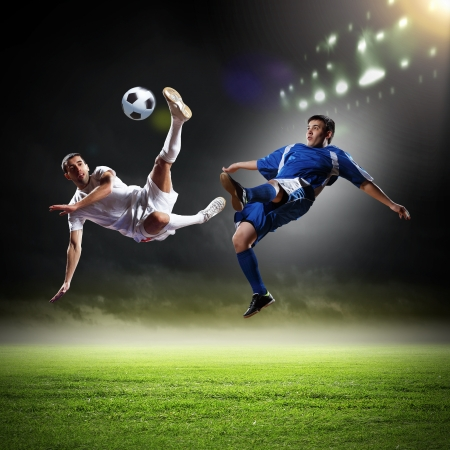 soccer players: Image of two football players at stadium Stock Photo