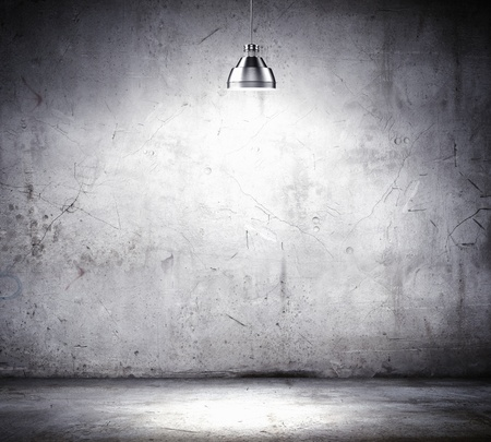 Stone blank wall illuminated with hanging above lamp  Place for text photo
