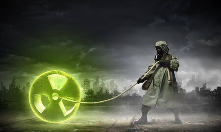 Man in respirator against nuclear background,  Radioactivity concept Stock Photo - 21439669