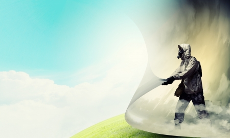 Image of man in gas mask turning page  Ecology concept Stock Photo - 21439592